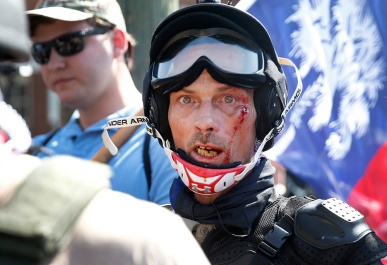 A person with Unite the Right in Charlottesville on Saturday Aug. 12, 2017. Unite the Right was protesting the changing of the name of Lee Park.