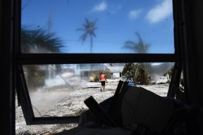 """Ely Chavez works to clear debris from her home`following Hurricane Irma in the Tavernier area located in the Florida Keys on Tuesday September 12, 2017 in Tavernier, FL. The family was able to get back to see their home for the first time today. """"Didn't expect it to be this bad"""", Ely's husband, Kevin said while referring to his home."""