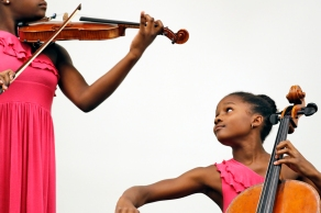 Violinist Kearston Gonzalez, left, and cellist Kendall Gonzalez perform to an audience gathered at the Tabb Library in York County Wednesday afternoon August 9, 2017. The sisters have performed at WNBA and NBA games in Washington, D.C., Charlotte and Houston and both have performed as a soloists with orchestras and won musical competitions.