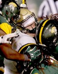 William & Mary quarterback Tommy McKee gets crunched by the Norfolk State defense as he runs during the fourth quarter Saturday September 9, 2017 at Norfolk.
