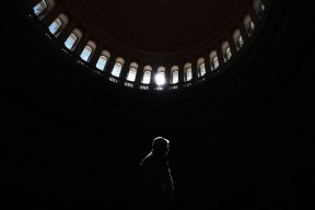 A visitor is illuminated while passing through the rotunda at the United States Capitol on Wednesday May 03, 2017 in Washington, DC.