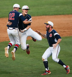 Spotsylvania High School team members Jonathan Rivard (left), Eugene Snyder (center) and Daniel Brooks celebrate their team's 7-5 victory over Tabb in the 3A Region finals at Spotsylvania on Thursday, June 1, 2017. The Knights will be heading to the state championships for the first time in school history.