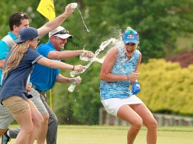 Lexi Thompson celebrates with friends Dan and Sydney Steger after winning the 2017 LPGA Kingsmill Championship Sunday May 21st. Thompson set a tournament record at 20 under beating Annika Sorenstam's record set in 2008.