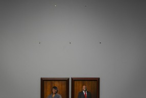 Portraits of Sonya Chapman and Davy Smith, along with five empty nails line the wall during a PRHA board meeting at the Portsmouth Redevelopment and Housing Authority building in Portsmouth, Va., on Thursday, March 23, 2017. Five of the boards seven members were fired or resigned from their positions recently.