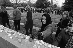 "Abide Sindhoo places a stone on the Holocaust Memorial at Emek Sholom Memorial Cemetary at the end of the Standing Together RVA Solidarity Rally. The rally was a response to escalating ""bias, bigotry and divisive rhetoric"" in America."
