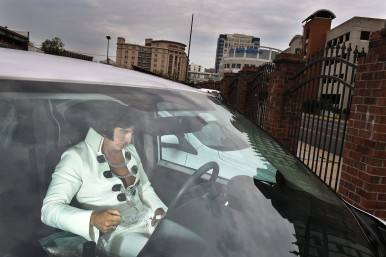 Elvis Tribute Artist, Ron Tutor, 52, of Tinley Park, TN prepares to perform while listening to music in his Dodge Caravan outside the New Daisy Theatre during the Images of the King World Championship on Sunday August 13, 2017 in Memphis, TN. August 11-19 is Elvis Week. This year marks the 40th year since Elvis Presley's death.