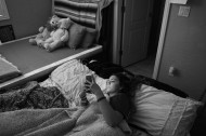 Gianna Baca rests in her room at her family's home after attending a student assembly at Faith Lutheran Middle School and High School on Friday October 06, 2017 in Las Vegas, NV. Gianna had her mattress on the ground so she would have a easier time getting into bed after getting shot in the leg.