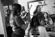 Gianna Baca, left, helps her twin sister, Natalia Baca, right center, with her hair at their family's home before they attended a homecoming football game at Faith Lutheran Middle School and High School on Friday October 06, 2017 in Las Vegas, NV. Natalia and Gianna were both shot by suspected gunman, Stephen Paddock while attending the Route 91 Harvest Festival.