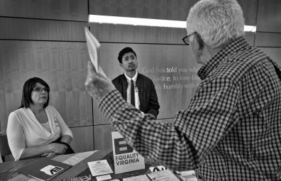 UNITED STATES - 03-18-2017: Connie Rice, a transgender woman from Leesburg, and Rae Obeyer, a transgender man with Equality Virginia, have a heated debate with a man attending the United Christian Parish in Reston during the Social Justice & Peace Conference on LGBT rights.