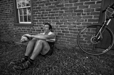UNITED STATES - July 30, 2017: Connie Rice, a life long cyclist, takes a break at the old Waterford Mill on one of her gravel road rides in Western Loudoun.