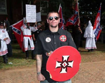 Members of the Loyal White Knights of the Ku Klux Klan rally at Justice Park on Saturday, July 8, 2017.