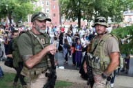 Militia members position themselves between people attending the Unite the Right rally and counter-protesters at Emancipation Park before the scheduled start of the Unite the Right rally in Charlottesville on Saturday, August 12, 2017.