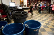 Fourth graders in Lora Roop's science class study in her room close to buckets that collect waste from a leaky ceiling on Monday, Dec. 18, 2017 at Flatwoods Elementary School in Jonesville, which is part of the Lee County public school system.