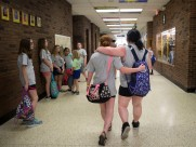 Students walk back into Appalachia Elementary on the third to last day of the school year after returning from a field trip at Natural Tunnel State Park on Wednesday, May 17, 2017. A recent vote by the Wise County School Board closed the school permanently.