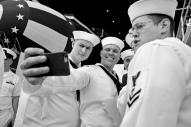 Crew members of the submarine USS Indiana take selfies before the start the christening of the Virginia-class submarine Indiana at Newport News Shipbuilding Saturday morning April 29, 2017.