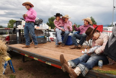 Ryder Martin, 1, right, is held by his mother's friend, Ginny Harrington as they gather with others at the Carbondale Wild West Rodeo on Thursday July 20, 2017 in Carbondale, CO. Many people watch the rodeo from the back of vehicles or trailers. The weekly rodeo is in it's 13th year at it's current location. It runs from June to mid-August.