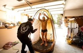 Personal trainer, Joe Hartfelder, owner of Straight Edge Fitness gives Jon Atkins,19, a spray tan Friday afternoon, Feb.17,2017 in preparation of Atkins' first body building competition. Hartfelder set up a tent in the garage of Atkins' grandparents, Jimmey and Cindy Sykes in Virginia Beach for the tanning. Atkins competed Saturday, Feb.18, 2017 in his first body building competition, The Body Sculpting Open Championships at The American Theatre. Atkins, who has Down Syndrome has worked with Hartfelder for the past year in preparing for the competition.