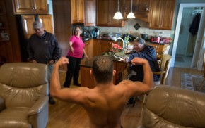 Jon Atkins,19, shows his routine to his grandparents, Jimmey and Cindy Sykes and his mother, Lisa Dudley, right, as he waited by the fireplace for his spray tan to dry Friday afternoon, Feb.17,2017. Atkins would compete in his first body building competition Saturday, Feb.18, 2017 during The Body Sculpting Open Championships at The American Theatre. His personal trainer, Joe Hartfelder came to his grandparents house to give Atkins a spray tan in preparation for the body building competition.