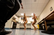 Jon Atkins,19, left, and Ethan Wyatt,18, of Virginia Beach practice their posing with their trainer, Joe Hartfelder Saturday morning, Feb.18, 2017 shortly before the start of The Body Sculpting Open Championships at the American Theatre.Atkins has worked with personal trainer Joe Hartfelder for the past year in preparing for the competition. Atkins competed in the Men's Physique Challenged category. Wyatt who also works with personal trainer Hartfelder competed in the Men's Bodybuilding Novice and Open categories.