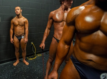 Jon Atkins,19, left, stands with other competitors Saturday morning, Feb.18, 2017 just off stage at The American Theatre before taking the stage during The Body Sculpting Open Championships. Atkins has worked with personal trainer Joe Hartfelder for the past year in preparing for the competition. Atkins competed in the Men's Physique Challenged category.