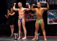 Steve Alexy ,43, of Franklin,VA and Jon Atkins ,19, right, pose for the crowd after receiving their trophies Saturday, Feb.18, 2017 on stage at The American Theatre during The Body Sculpting Open Championships. Atkins has worked with personal trainer Joe Hartfelder for the past year in preparing for the competition. Atkins and Alexy who has Cerebral palsy, competed in the Men's Physique Challenged category. Alexy won first place and Atkins, second in the category.
