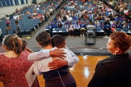 Huntington Middle School student Hezekiah Brown, center, hugs teacher Rhonda Ross while at the eighth grade awards and promotion ceremony during the last day of school Thursday afternoon June 14, 2018.