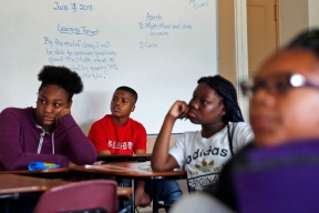 Brandon Driggins, center and other Huntington Middle School students listen in class during the last day of school Thursday afternoon June 14, 2018. It closed its doors as a high school in 1971 and reopened that fall as the desegregated Huntington Intermediate School, later switching to the middle school model in 1981.