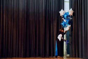 Huntington Middle School eighth grade counselor Mukier Williams carries balloons off the stage following the eighth grade awards and promotion ceremony during the last day of school Thursday afternoon June 14, 2018.