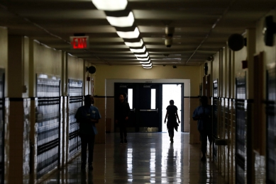 A Huntington Middle School student walks through a hallway during the last day of school Thursday afternoon June 14, 2018.