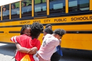 Huntington Middle School students embrace before departing on buses during the last day of school Thursday afternoon June 14, 2018.