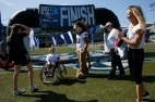 Stacy and Bill watch on as Jackson Saville celebrates crossing the finish line with Big Blue at the Big Blue 1K Kids Race at Old Dominion University on Saturday April 14, 2018. Saville trained for the event through a program called Mighty Monarchs, a program for special needs children that introduces them to a variety of adapted sports. Prior to his Spinraza injects, the Saville family had ordered a motor to help Jackson navigate his chair as his body weakened, but his strength has grown and he was able to participate in a 1K, something his mother Stacy says she never thought would be possible for her son prior to his Spinraza injections.