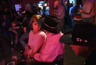 People gather at Bob's Cowboy Bar following an evening rodeo performance during Pioneer Days on Friday May 04, 2018 in Guymon, OK. This was the 86th year of the event. The bar was a gathering place for rodeo participants and others with live music and dancing.