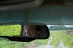 "3rd PLACE PORTRAIT: KAITLIN MCKEOWN, VIRGINIAN-PILOT--Wink Henley drives his pickup truck through the rain-soaked fields of his Virginia Beach farm on July 28, 2018. Days of steady rain have saturated the ground and prevented Henley from using larger equipment that's necessary to plant fall crops. ""I like to say farming is almost like Atlantic City or Las Vegas,"" Henley said, ""If everything works good, it's an enjoyable occupation because you watch stuff grow, everything does good. But when you get something like this, and you sit there and watch a crop wither up and die, it gets kind of disheartening."""