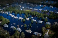 Dozens of homes are overtaken by floodwaters brought to the area by Hurricane Florence in Pender County, N.C., on Saturday, September 22, 2018. The floodwaters have swallowed an estimated 25 percent of Pender county.
