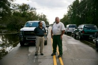 Harry Worley, Battalion Chief with the Norfolk Fire Department, and Mitch Harris, forest fire equipment operator with North Carolina Forest Service survey flooding and road closures in Pender County, N.C., on Friday, September 21, 2018.