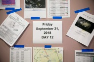 A sign labels the 12th day of activation at Pender County Office of Emergency Management in Burgaw, N.C., on Friday, September 21, 2018.