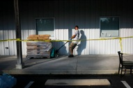 Thomas Thurston, of Rocky Point, N.C., helps move pallets of tarps at a supply distribution center set up by Pastor Jeff Daw at Lighthouse Worship Center in Rocky Point, N.C., on Saturday, September 22, 2018. Thurston showed up at the center for a hot meal on Friday and ended up returning to help out.