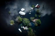 3rd PLACE NEWS: KRISTEN ZEIS, VIRGINIAN-PILOT--Home, vehicles and boats are swallowed by floodwaters from the Northeast Cape Fear River brought to the area by Hurricane Florence in Pender County, N.C., on Sunday, September 23, 2018. Hurricane Florence made landfall on Friday, September 14, 2018 and brought over 23 inches of rain to the area. The storm left over 2,400 storms damaged in Pender County with an estimated 25 percent of the homes underwater.