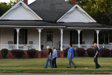 Former President of the United States, Jimmy Carter walks with his wife, former First Lady, Rosalynn Carter along with Secret Service along West Church Street following dinner at a friend's home on Saturday August 04, 2018 in Plains, GA. Born in Plains, GA, President Carter stayed in the town following his presidency.