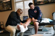 Physical therapist, Leonard Gordon Jr., left, works with Kyle Laman, 15, during a rehabilitation session at U18 Sports Medicine on Monday April 23, 2018 in Coral Springs, FL. Laman was shot during a mass shooting at Marjory Stoneman Douglas High School. He has had several surgeries near his foot since the shooting.
