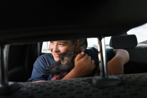 Kyle Laman, 15, rides in his family's truck with his new service dog, Bruce after picking up the dog near the Fort Lauderdale- Hollywood International Airport on Sunday April 22, 2018 as they traveled from Fort Lauderdale, FL to Coral Springs, FL. Laman was shot during a mass shooting at Marjory Stoneman Douglas High School. Kyle thought about naming the dog, Zeus, but stuck with Bruce.