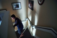 Kyle Laman, 15, makes his way down stairs at his family's home on Saturday April 21, 2018 in Coral Springs, FL. Laman was shot during a mass shooting at Marjory Stoneman Douglas High School.