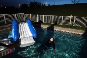 Kyle Laman, 15, plays in his family's pool on Friday April 20, 2018 in Coral Springs, FL. Laman was shot during a mass shooting at Marjory Stoneman Douglas High School.