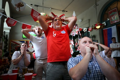 1st PLACE SPORTS: SHELBY LUM, RICHMOND TIMES-DISPATCH--Fans react to the England vs. Croatia game at Penny Lane Pub on Wednesday July 11, 2018. Croatia won the game 2-1.