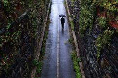 3rd PLACE FEATURE: MATT MCCLAIN, WASHINGTON POST--An umbrella clad pedestrian walks through the Wilkes Street Tunnel on a rainy Sunday September 09, 2018 in Alexandria, VA.