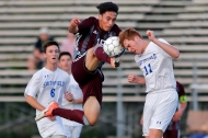 3rd PLACE SPORTS: JONATHON GRUENKE, DAILY PRESS--Chancellor's Jesse Ramirez, center, attempts to kick the ball away from Smithfield's Brayden Bird, right, during Tuesday's Class 4 state tournament quarterfinal game at Smithfield High School June 5, 2018.