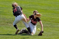 HM SPORTS: JONATHON GRUENKE, DAILY PRESS--Cave Spring's Taylor Lving, left, and Hannah Muncy collide and lose control of the ball during Saturday's Class 3 state softball tournament championship at the Moyer Sports Complex June 9, 2018.