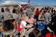 1st Place News: Jonathon Gruenke, Daily Press---Tech Sgt. Grant Kiekhaefer kisses his two-year-old daughter Kori Kiekhaefer during a homecoming ceremony at Langley Air Force Base Tuesday afternoon October 9, 2018. One hundred eighty-seven members of the 1st Fighter Wing returned home after a six month deployment in the Middle East.