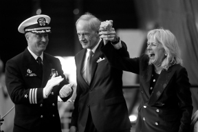 Jill Biden, right, celebrates with Senator Thomas Carper, center, and Commander Brian Hogan, left after smashing a bottle of sparkling wine during the christening ceremony for the submarine Delaware at Newport News Shipbuilding Saturday morning October 20, 2018. Delaware will be the ninth Virginia-class submarine that Newport News has delivered and 18th in the entire class.