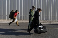 New trainees carry their luggage to their dorms at the United States Border Patrol Academy on Wednesday August 29, 2018 in Artesia, NM. The academy is on the grounds of the Federal Law Enforcement Training Center.